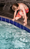 Boy Playing in Pool Royalty Free Stock Photography