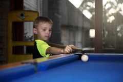 Boy playing pool Stock Images