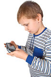 Boy playing psp. Boy playing portable video game Royalty Free Stock Photos