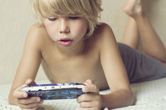 Boy playing on the PSP Royalty Free Stock Photography