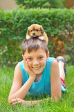 Boy playing with a puppy Royalty Free Stock Photo