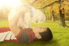 Boy playing puppy at the park Royalty Free Stock Images