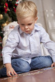 Boy playing with puzzle Royalty Free Stock Photo
