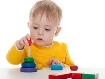 Boy playing pyramid Royalty Free Stock Photography