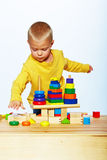 Boy playing with pyramid Stock Photo