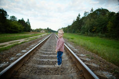 Boy playing on the railroad. Photo oflittle boy playing on the railroad royalty free stock photo