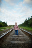 Boy playing on the railroad. Photo oflittle boy playing on the railroad royalty free stock image