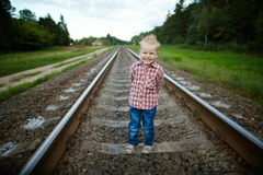 Boy playing on the railroad. Photo oflittle boy playing on the railroad stock photography