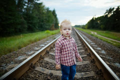 Boy playing on the railroad royalty free stock images