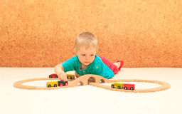 Boy playing with railroad toy Royalty Free Stock Image