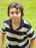 Boy playing in the rain. Boy completely wet and playing in the rain Stock Photo