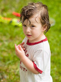Boy playing in the rain. Boy completely wet and playing in the rain Stock Photography