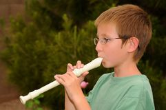 Boy playing a recorder Stock Photography