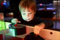 Boy playing with refraction of light. In lab Royalty Free Stock Photography