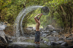 Boy playing in the river. Asian boy playing in the river Royalty Free Stock Photo