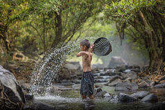 Boy playing in the river. Asian boy playing in the river Stock Photo