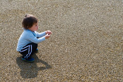 Boy Playing with Rock Stock Images