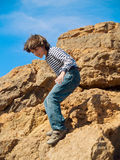 Boy playing in rocks Royalty Free Stock Photos