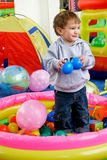 Boy in playing room. Happy boy in playing room Royalty Free Stock Images