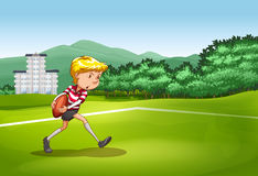 Boy playing rugby in the field Royalty Free Stock Image