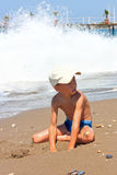Boy playing in the sand. Stock Photos