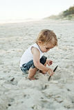Boy playing in sand Royalty Free Stock Photo