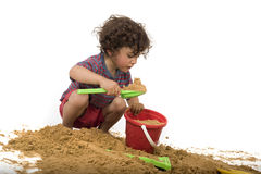 Boy playing in the sand. Isolated on white stock photography