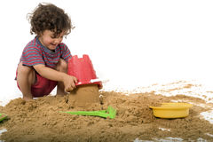 Boy playing in the sand. Isolated on white royalty free stock photos