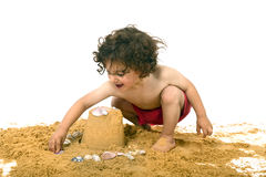 Boy playing in the sand Stock Photo