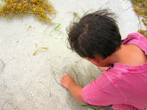 Boy playing in sand. Overhead view of young boy playing on sandy beach Stock Image