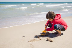 Boy playing in the sand Royalty Free Stock Photography