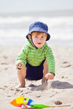 Boy playing on sand beach Royalty Free Stock Photography