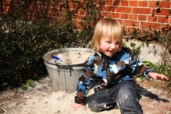 Boy playing beside sand box Stock Photography