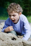 Boy playing in the sandbox. Alone or with friends Royalty Free Stock Photography