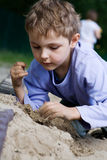 Boy playing in the sandbox Royalty Free Stock Image