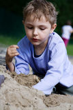Boy playing in the sandbox. Alone or with friends Royalty Free Stock Images