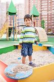 Boy playing in sandbox Stock Photography