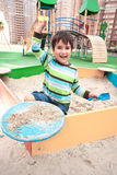Boy playing in sandbox Royalty Free Stock Photography