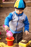 Boy Playing in Sandbox Royalty Free Stock Photo