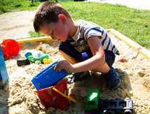 Boy playing in the sandbox Royalty Free Stock Photography