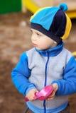 Boy Playing in Sandbox Stock Images