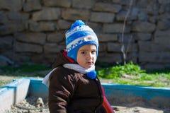 Boy playing in the sandbox Stock Photo