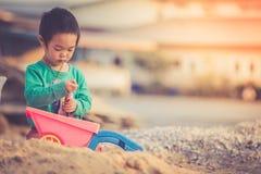 Boy playing in sandbox. Little boy playing in sandbox, vintage Royalty Free Stock Photography