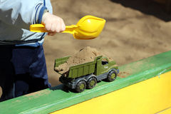 Boy playing in sandbox Stock Photo