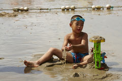 Boy playing sands in beach Royalty Free Stock Image