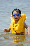 Boy playing at sea. Picture of a little chinese boy standing in sea water Royalty Free Stock Photography