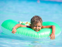Boy playing in the sea Royalty Free Stock Photos