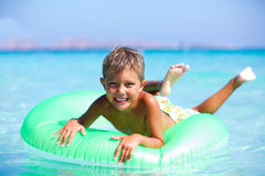 Boy playing in the sea Stock Image