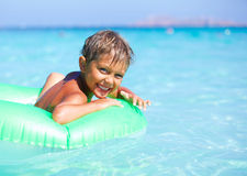 Boy playing in the sea Royalty Free Stock Image
