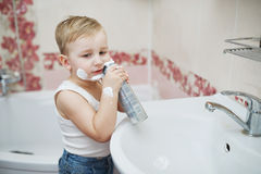 Boy playing with shaving foam Stock Image